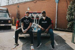 Lecrae and Terence deliver portable hand washing station.